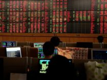 Worldwide MARKETS-Asian stocks drop on worries about new lockdowns, banking department